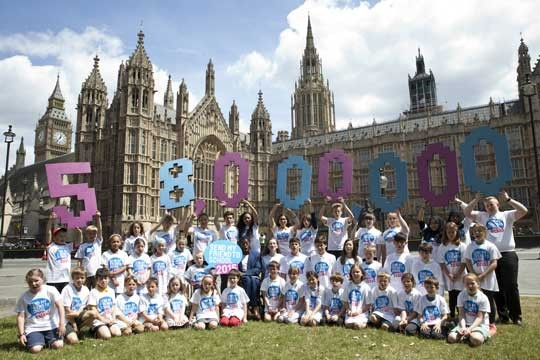 Over 50 children outside the UK Houses of Parliament calling for action to send every child to school.
